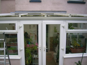 Conservatory roof and windows before a clean